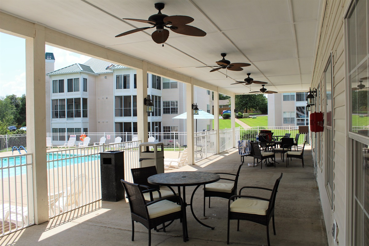Shaded veranda offers poolside seating.