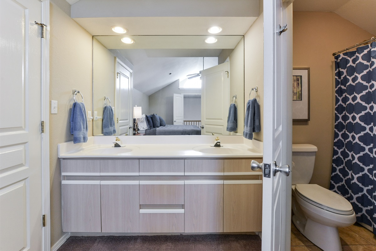 The Loft Suite features its own private bathroom with full tub and shower