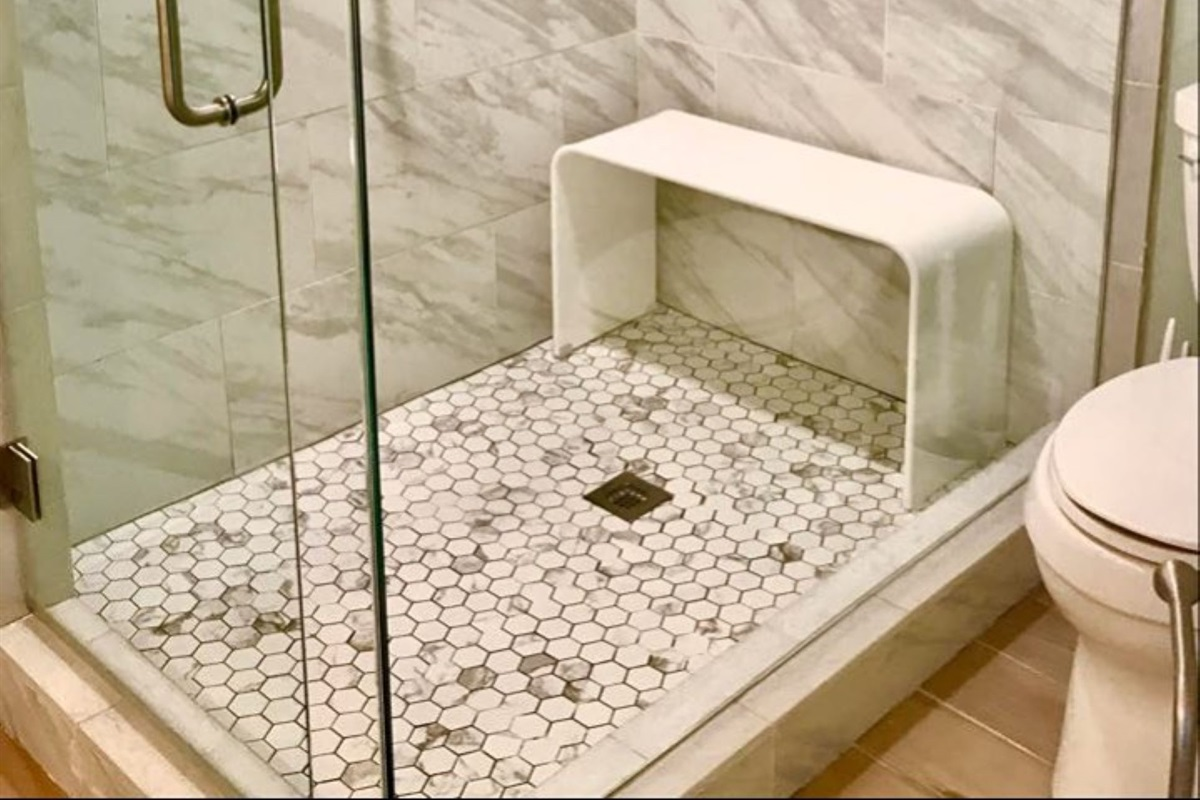 Large walk in shower with modern bench