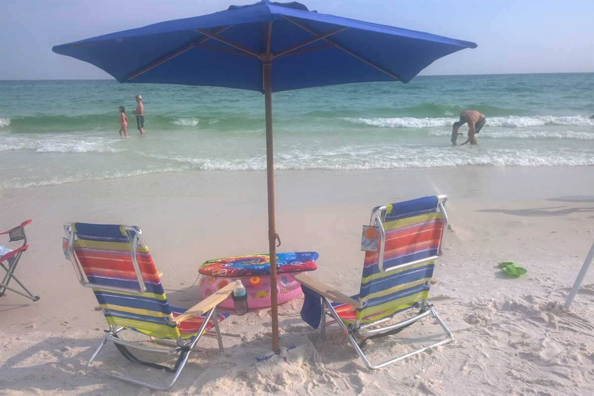 Complimentary beach chairs and umbrella