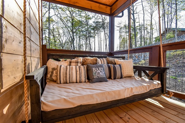 The front porch bed swing is the #1 rated napping spot!