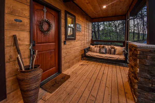 Inviting front porch with fantastic hanging bed.