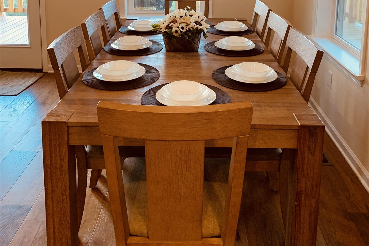 Dining room table for 8 with room for 8 more nearby