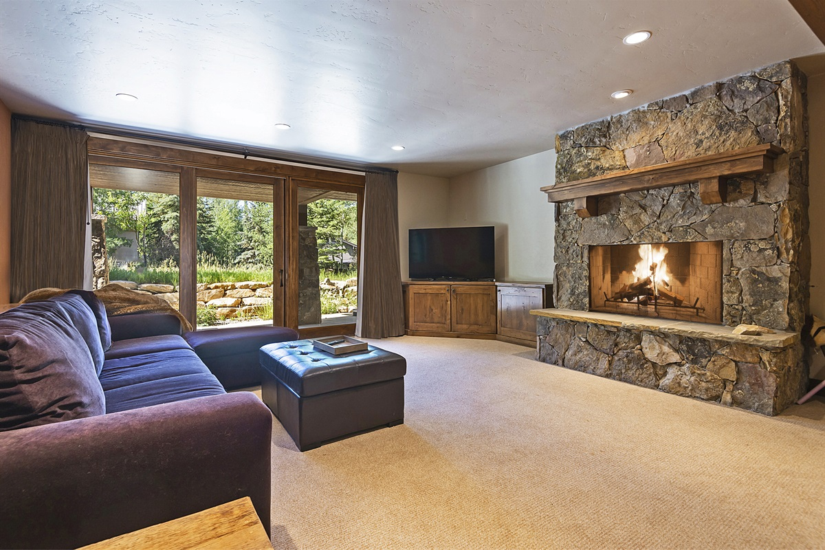 Downstairs living area - wood burning fireplace