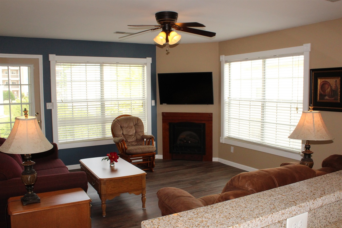 The living room seats 6. Door walks out to your screened porch.