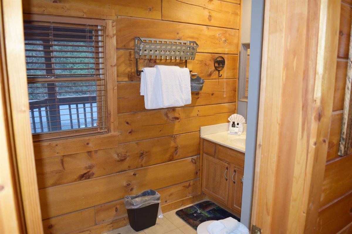 First floor bathroom has a tub shower.