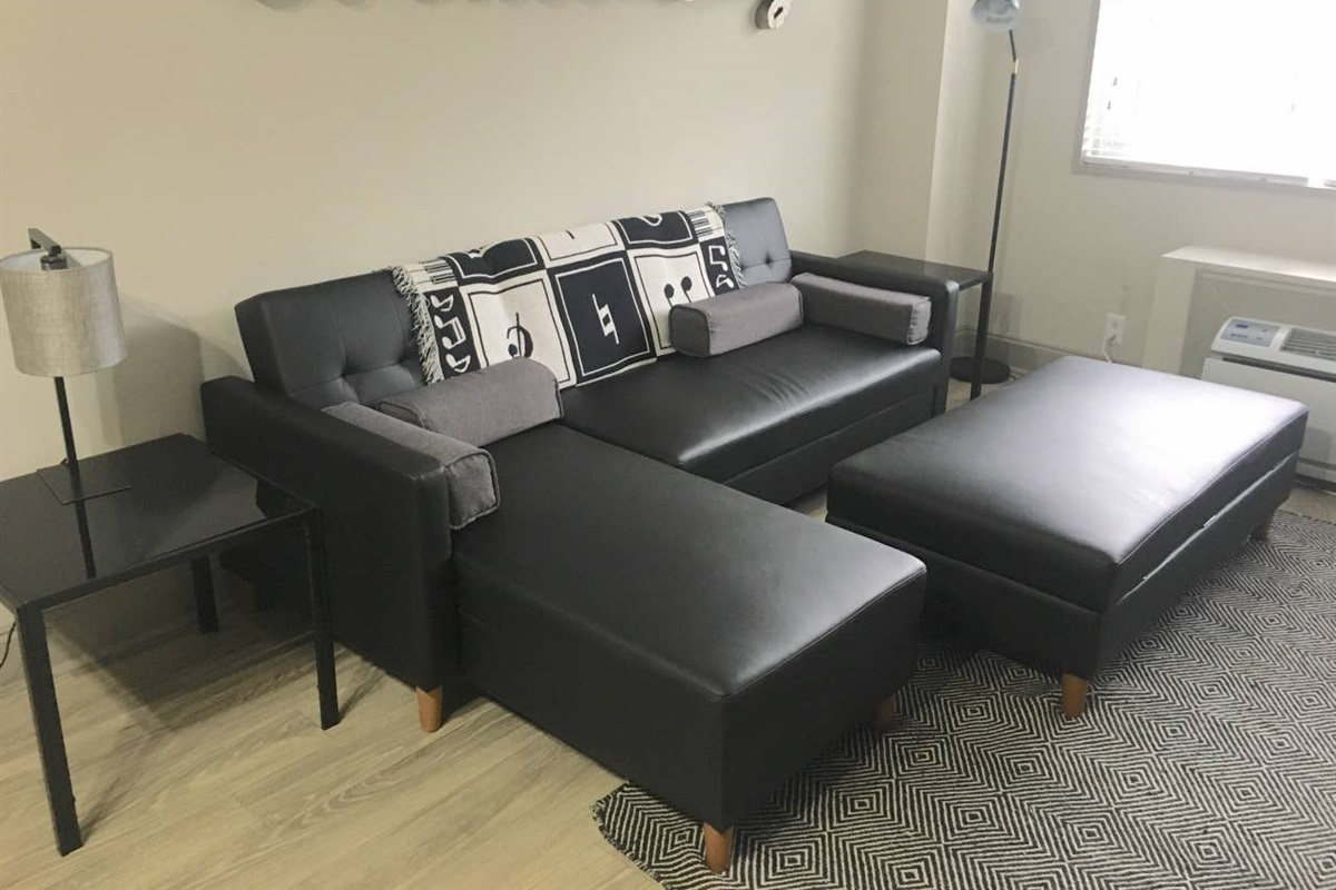 We've updated our apartment with a brand new L Shape Sectional that folds out to make a king size bed for extra sleeping room!