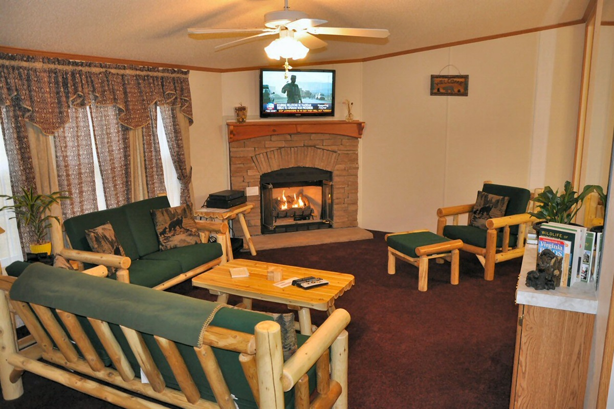 Spacious living room w/ fireplace and hi-def TV