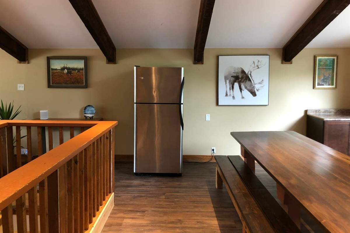 2nd fridge for your cold beverages strategically placed between dining and living rooms.