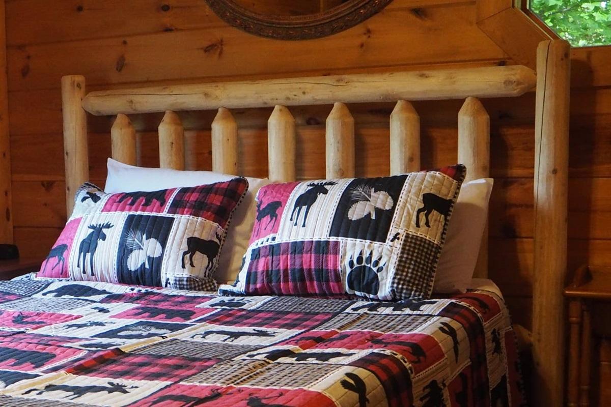 Comfortable queen bed in the loft bedroom.