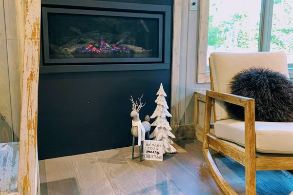 Warm up by the gas fireplace. Turns on with the flip of a switch!