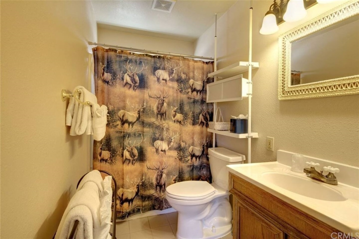 Bathroom #1: Upstairs full bathroom with shower that can be accessed from Kitchen & Bedroom #1.