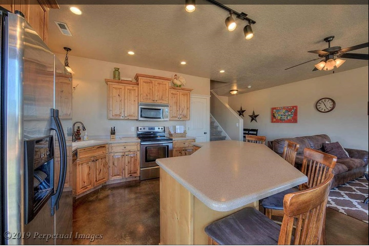 Fully Stocked Kitchen with Full Sized Stainless Appliances and spacious pantry