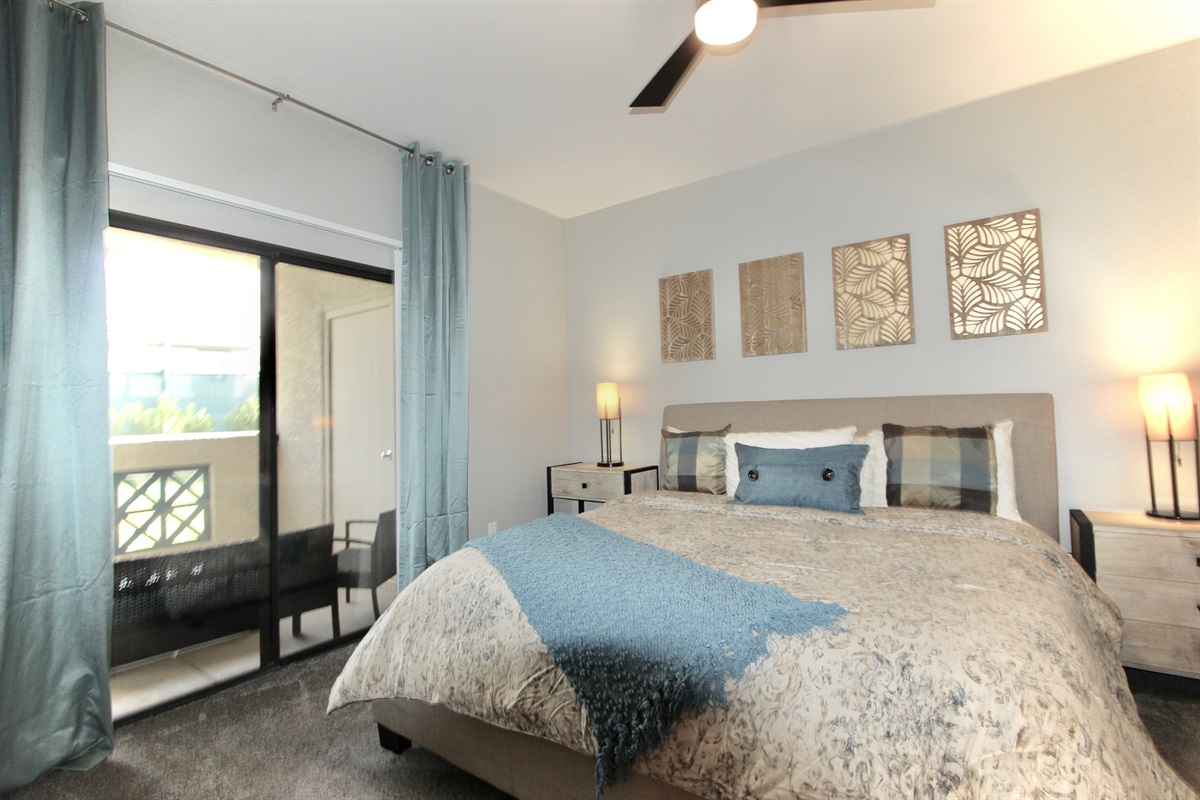 Master bedroom with king bed, walk out to patio.