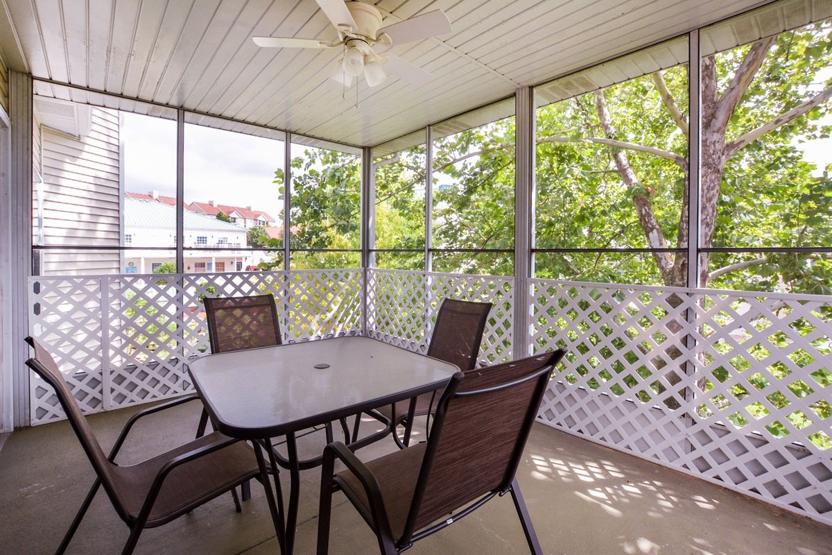 The screened-in patio stays bug-free while you dine alfresco to a babbling brook