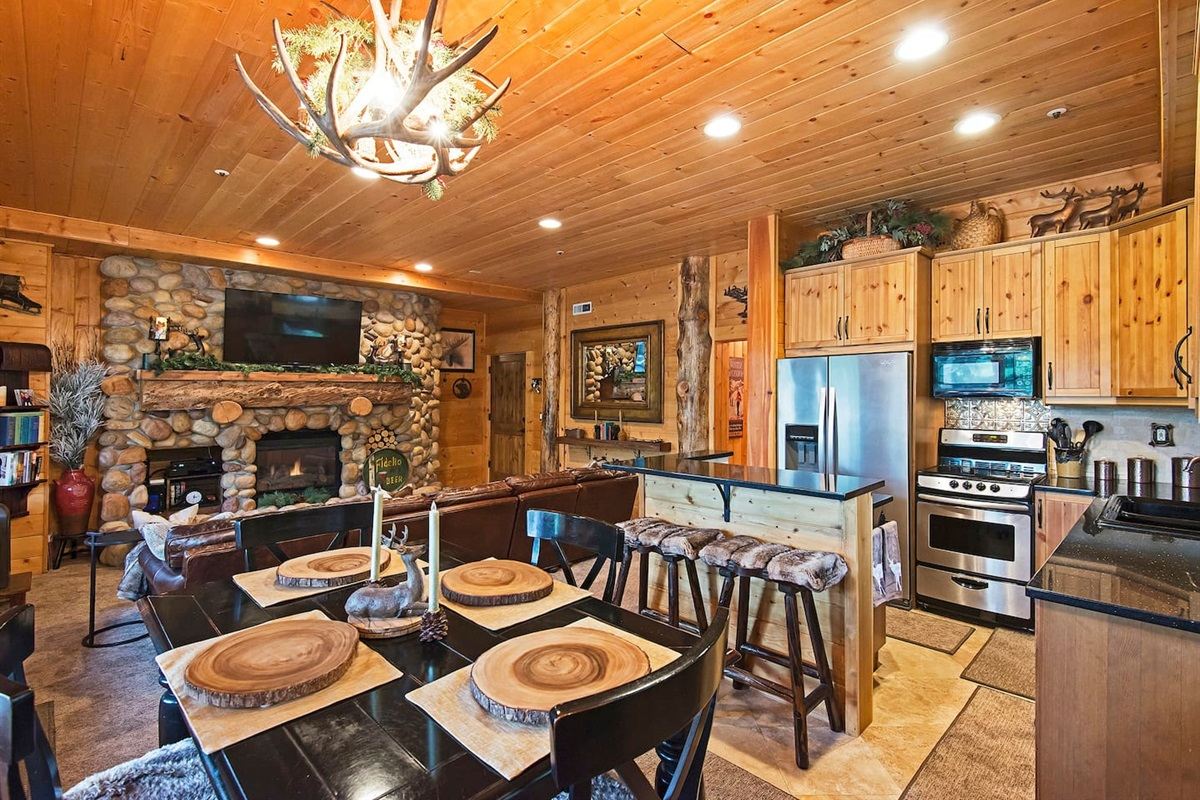Living area - TV, fireplace, bar area, dining, kitchen, deck with hot-tub, outdoor seating and amazing views
