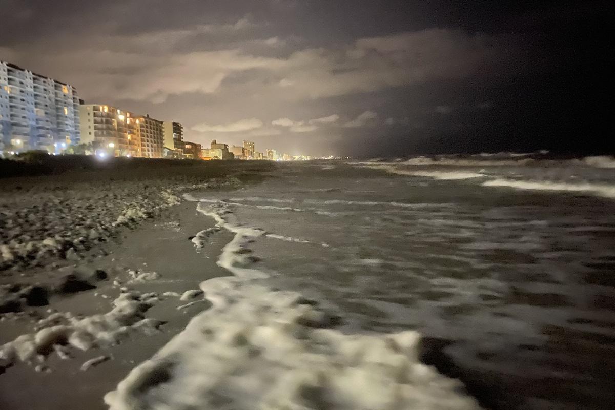 Take a late night beach stroll