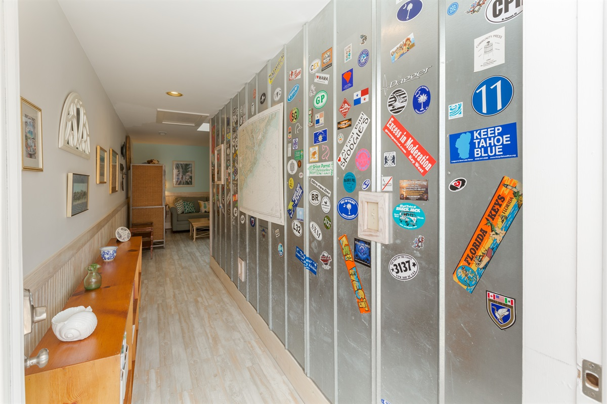 Welcome to High Life!  This is the famous wall of decals guests have brought from all around.