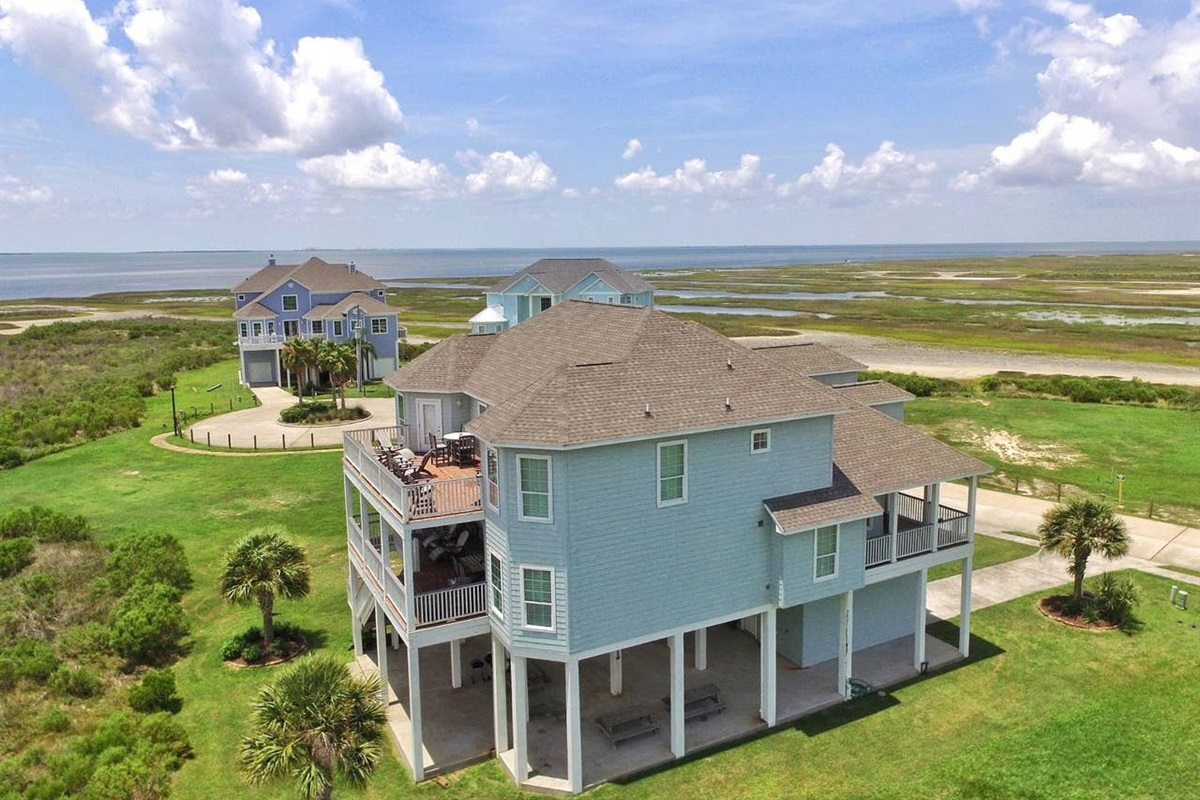 AerialView from Back Side of Bay House with Bay in Horizon