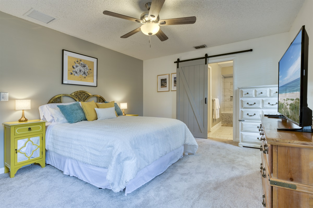 Newly decorated Master queen bedroom with barnyard door entry into En-suite bathroom and huge closet.