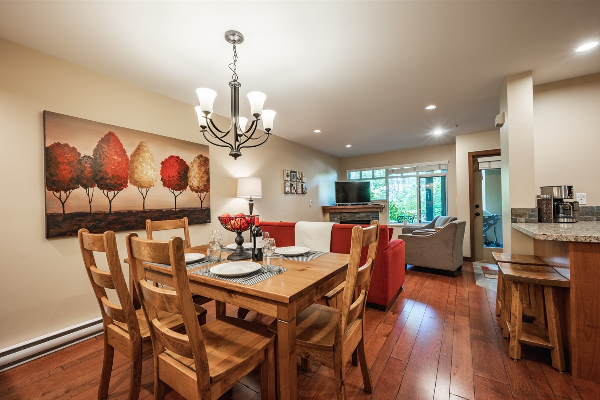 Dining and Living Room - opens onto kitchen, bar stools for morning coffee, spacious main area perfect for families or a group of friends.
