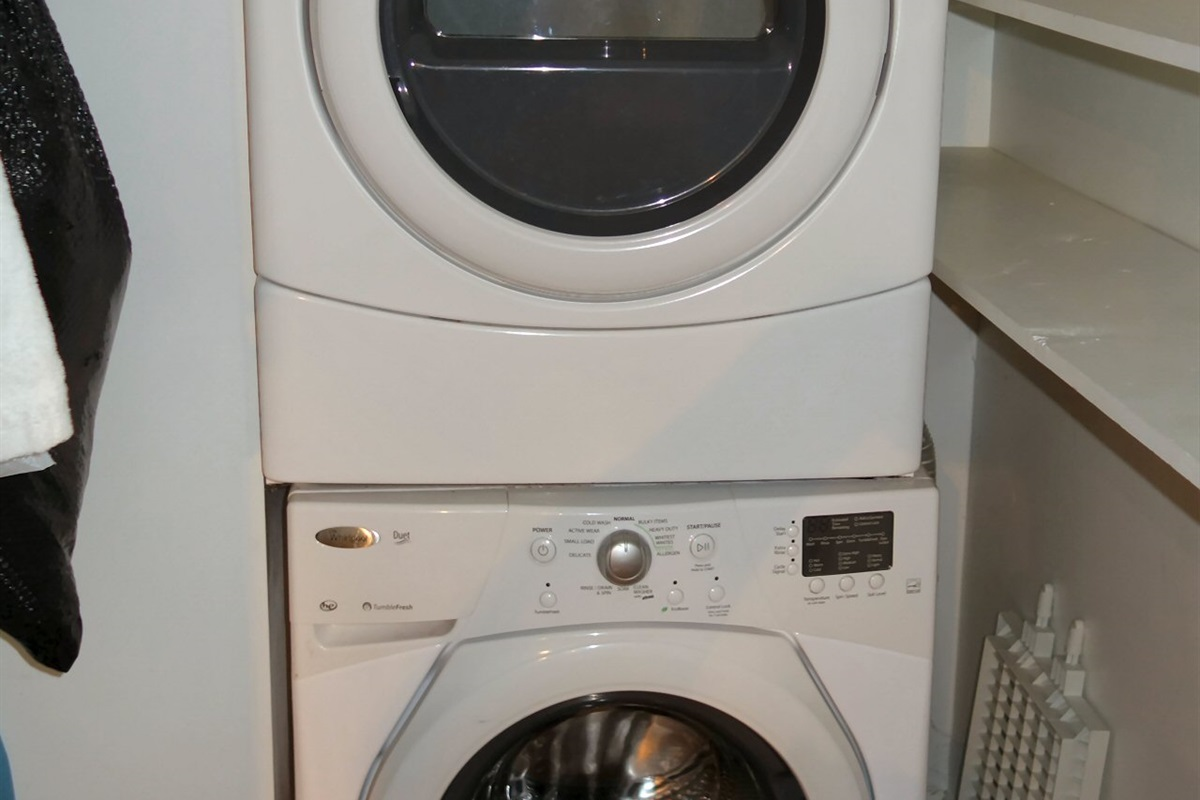 Full laundry room with modern efficient appliances