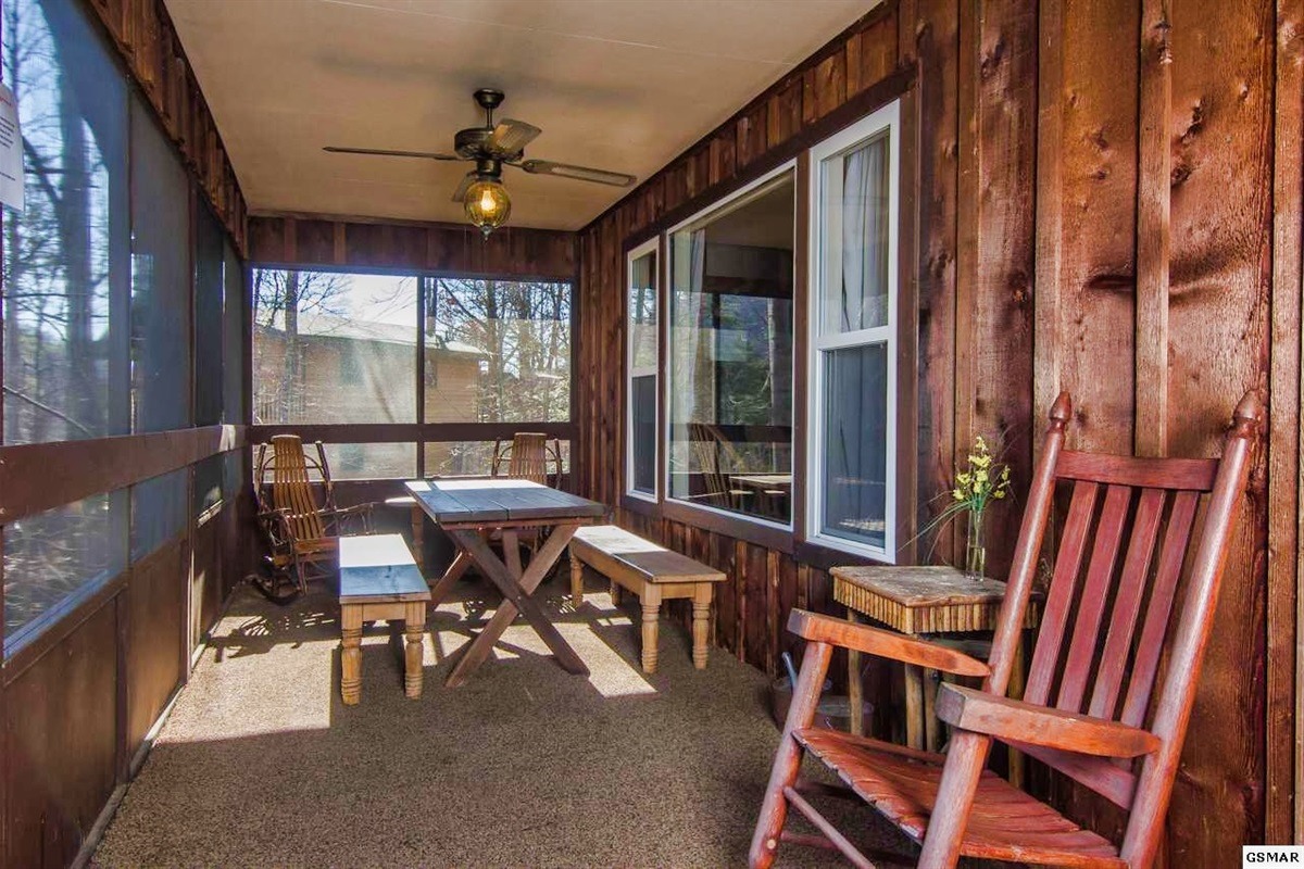 Screened-in deck with dining areas