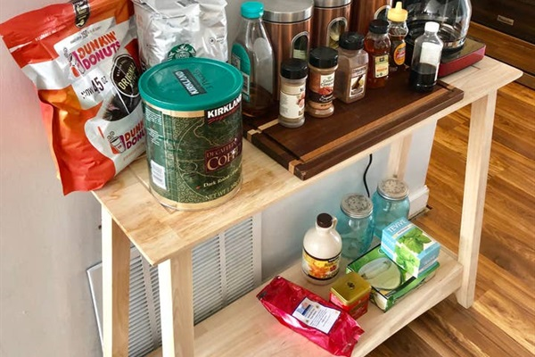 Coffee grounds, sweeteners & coffee pot.