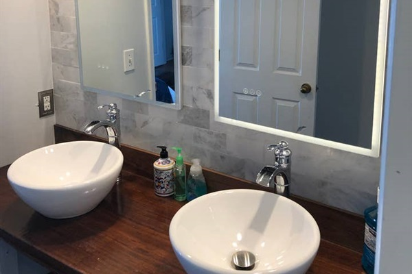 KING BEDROOM #1  (courtyard side)  Private vanity with double sinks & mirrors.