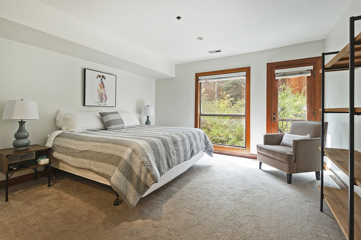 Master bedroom with king size bed, flatscreen TV, ensuite bath