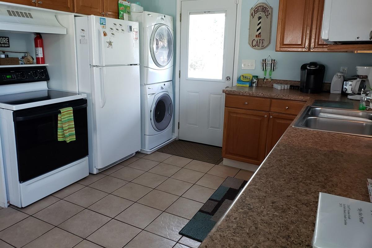 Fridge, stove, and full laundry