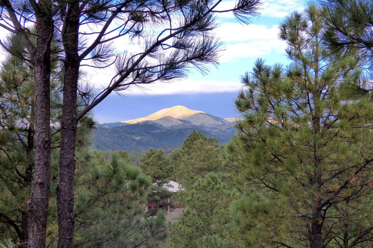 From the deck, Sierra Blanca Peak being lit up with the rising sun from the east.