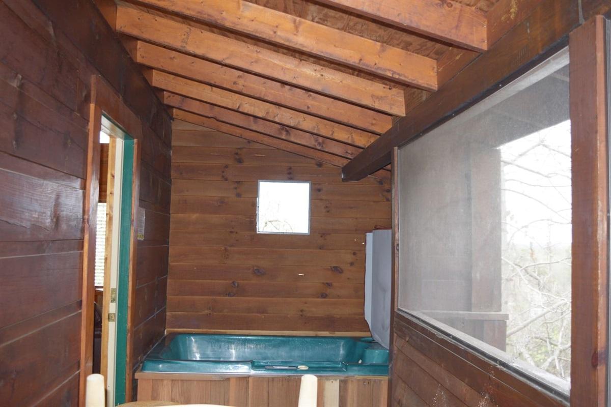 Soak in the hottub in the screened in porch.