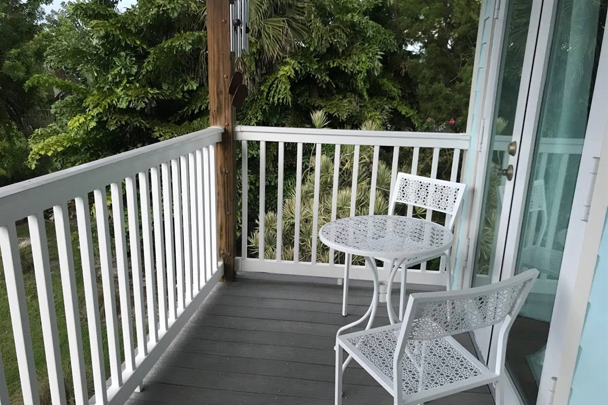 MASTER BEDROOM BALCONY WITH SEATING SET.