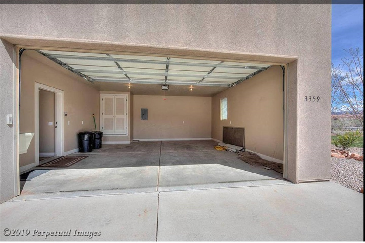 Secure Over sized 2 Car Garage for those Moab Toys, with Driveway and Street Parking