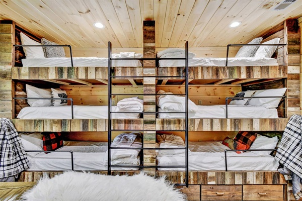 """Six twin sized (75"""" long) bunks are perfect for kids.  Adults are welcome, but the space between bunks might be a little tight."""