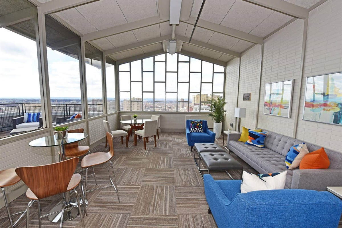Sky Lounge available 24/7 featuring covered views of the city.