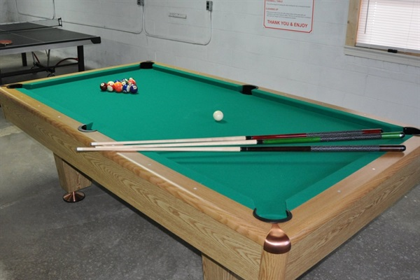 Tournament size pool table in game room