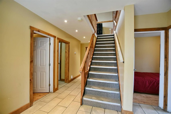 Hallway and staircase to top floor (kitchen, dining room & living room)