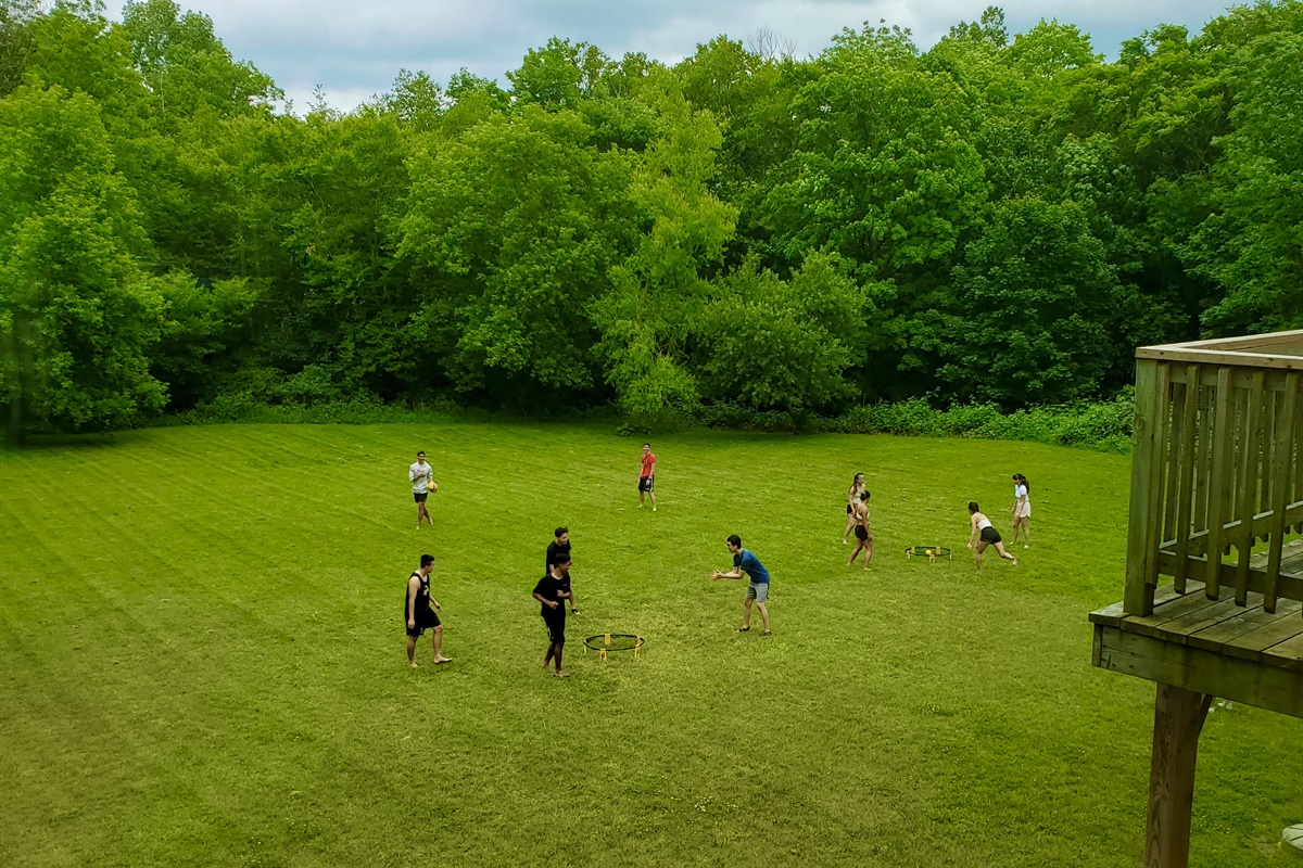 Playing your favourite game in the HUGE backyard. Spikeball, anyone?