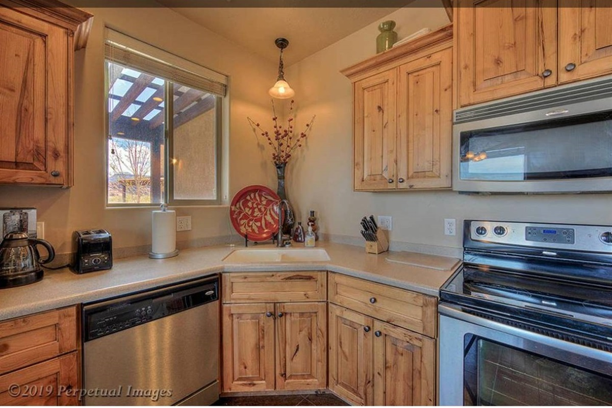 Fully-equipped kitchen with updated appliances