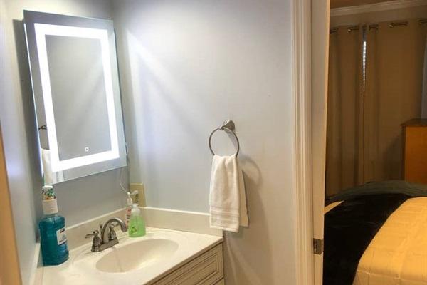 Bathroom features updated sink cabinet.