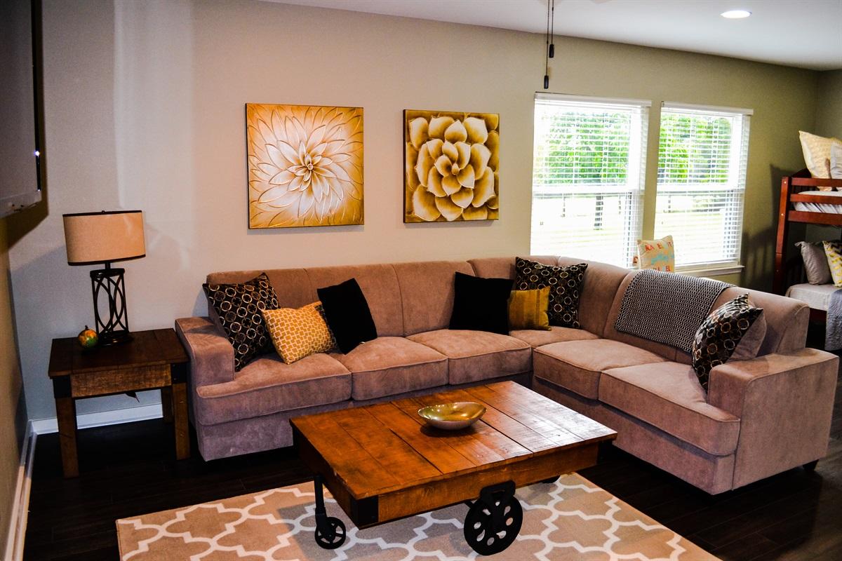 Living room #2 w/ mounted flatscreen TV.
