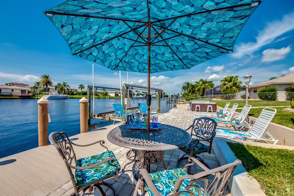 Waterside dining, sunbathing and hot tub