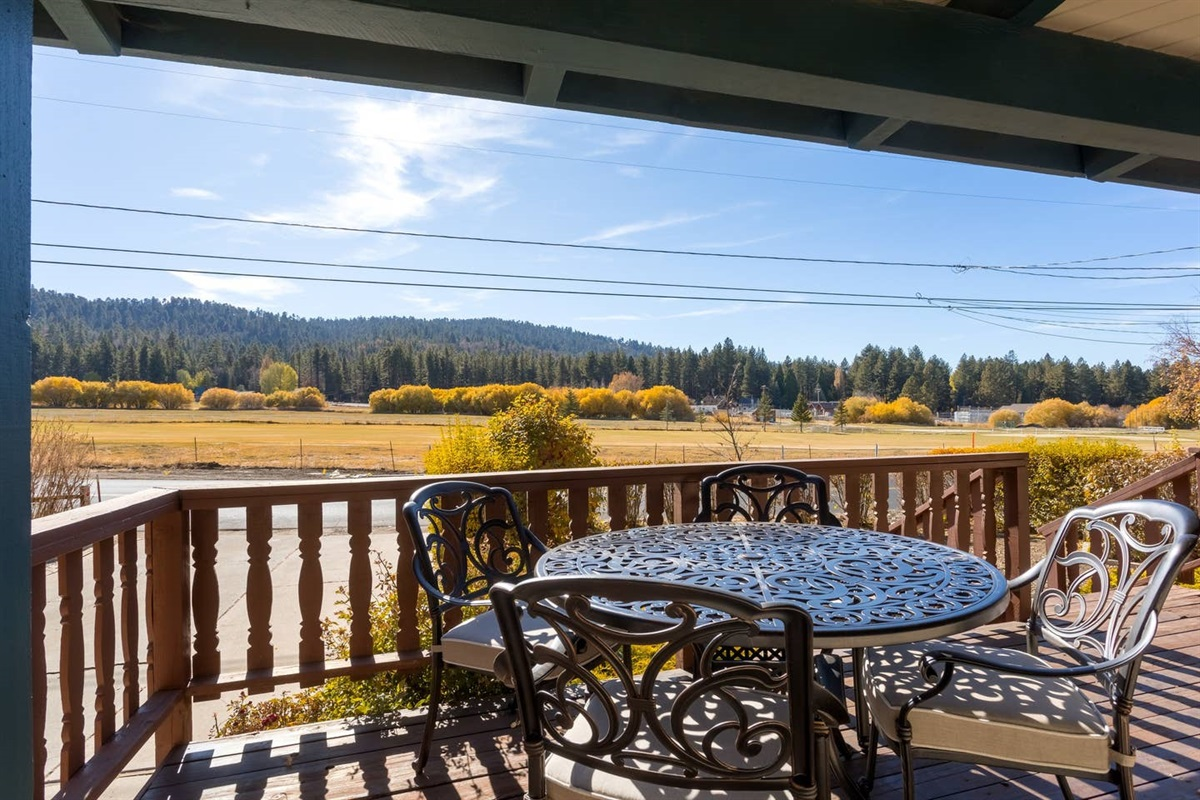 The front patio features an outdoor dining table for 4, porch swing, BBQ grill, & great view of Bear Mountain Golf Course's 4th hole directly across the street!