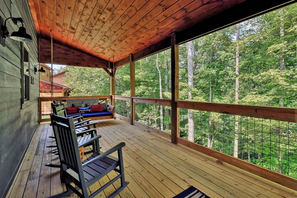 Main level deck with rockers and hanging bed