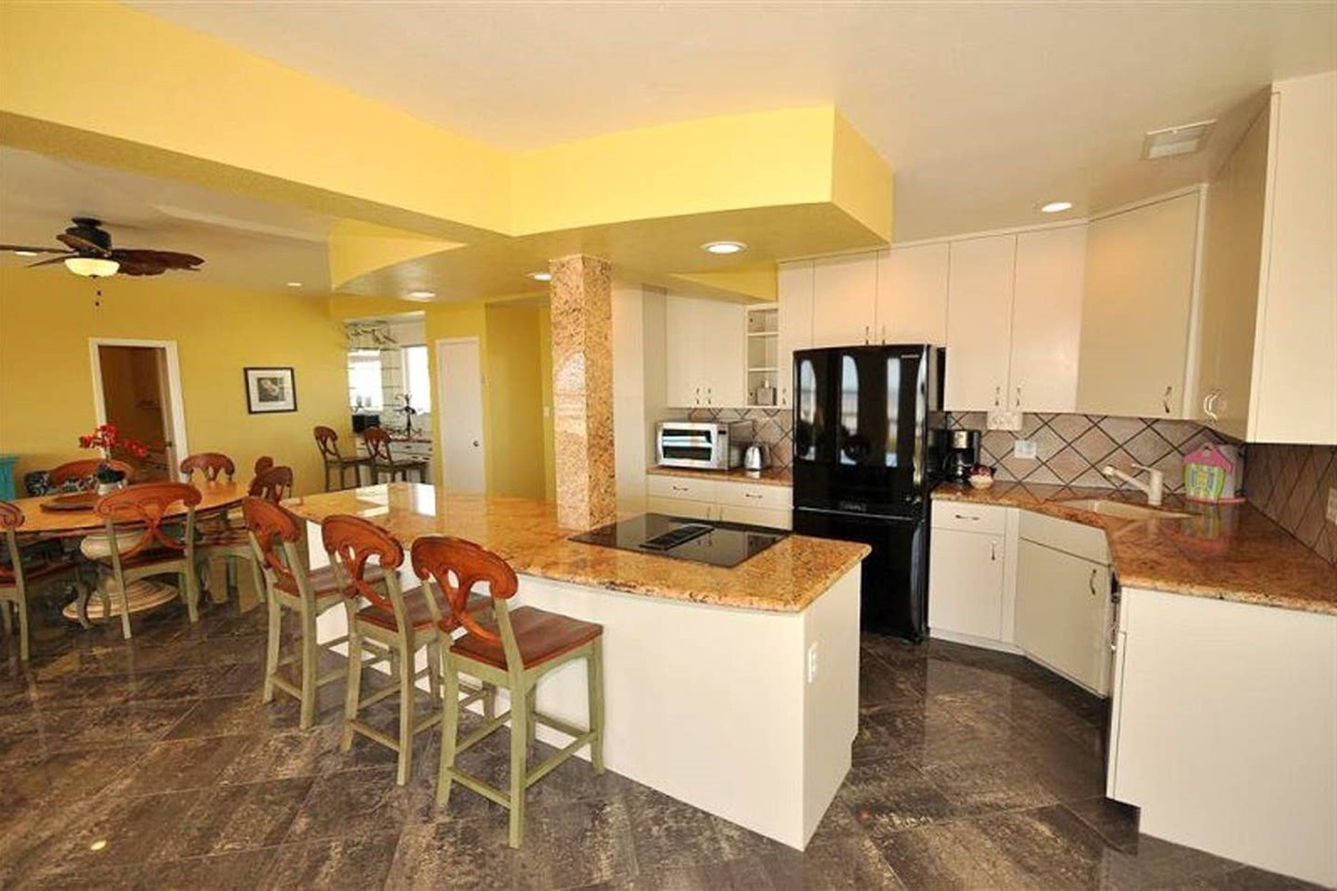 Kitchen with Granite Countertops & Bar - seats up to 3