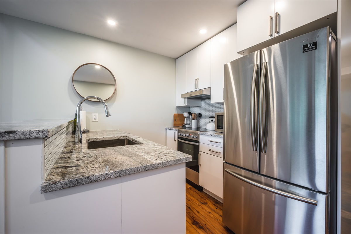 Kitchen - Brand new stainless steel appliances, fully stocked with cooking utensils, coffee, tea and hot chocolate included.