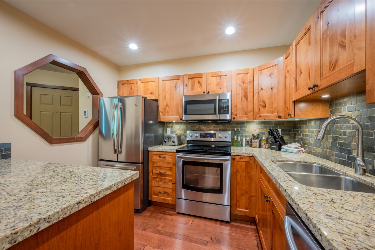 Kitchen - Fully renovated, modern stainless steel appliances, quartz countertops, FULLY equipped with cooking utensils. Espresso cups and percolator included!