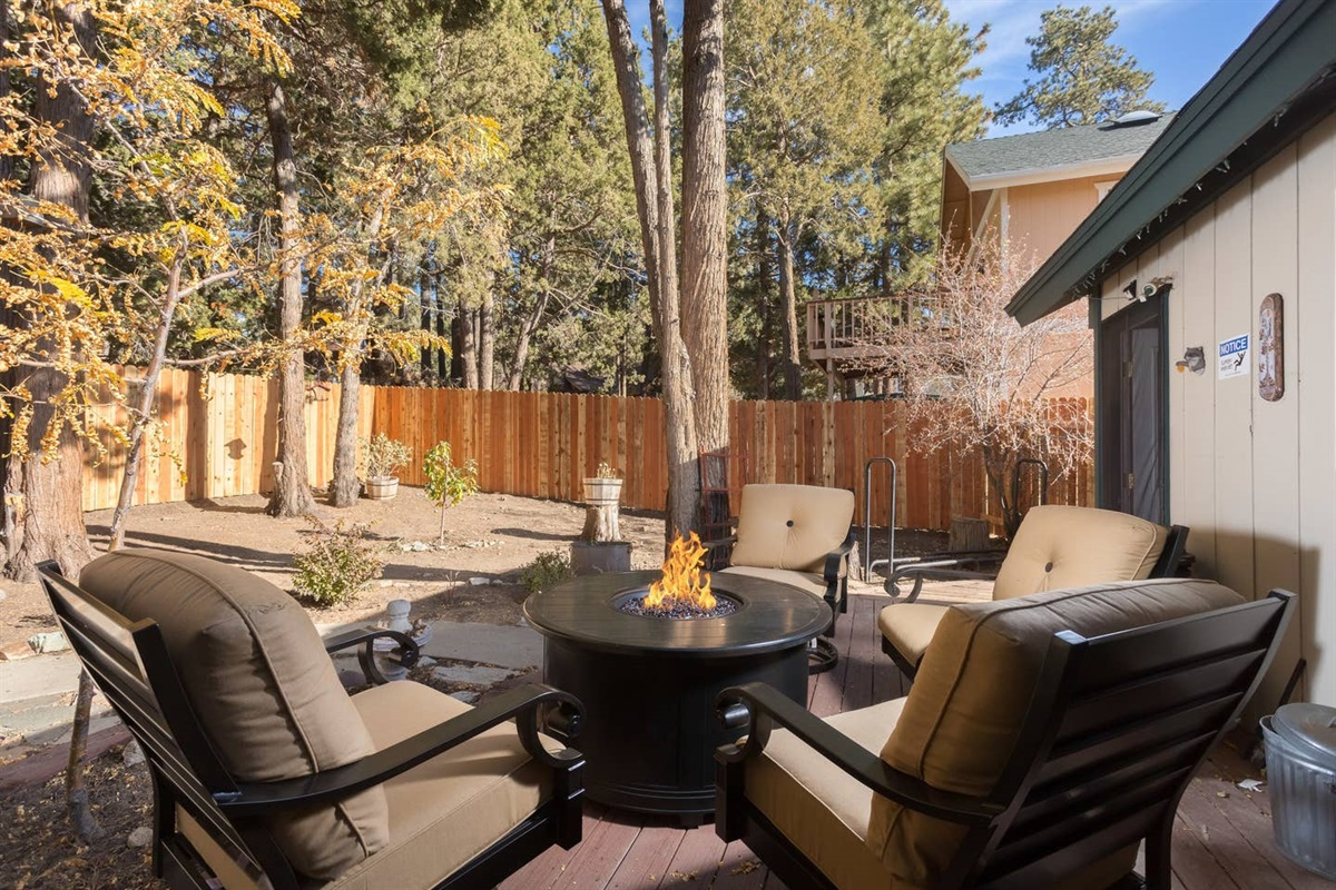 Back Patio: Moonridge Cabin has 2 patios. The back patio features a fully fenced backyard complete with fire pit, outdoor seating, & hot tub.